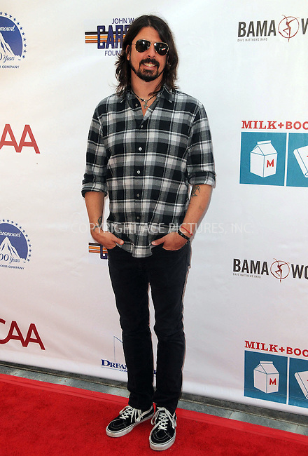 WWW.ACEPIXS.COM . . . . .  ....April 15 2012, LA....Dave Grohl arriving at the 3rd Annual Milk And Bookies Story Time Celebration at the Skirball Cultural Center on April 15, 2012 in Los Angeles, California.....Please byline: PETER WEST - ACE PICTURES.... *** ***..Ace Pictures, Inc:  ..Philip Vaughan (212) 243-8787 or (646) 769 0430..e-mail: info@acepixs.com..web: http://www.acepixs.com