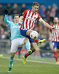 Atletico de Madrid's Gabi Fernandez (r) and PSV Eindhoven's Andres Guardado during UEFA Champions League match. March 15,2016. (ALTERPHOTOS/Acero)
