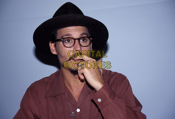 JOHNNY DEPP.January 2006.Ref: AW.headshot portrait glasses black hat goatee mustache finger in mouth ring.www.capitalpictures.com.sales@capitalpictures.com.© Capital Pictures.