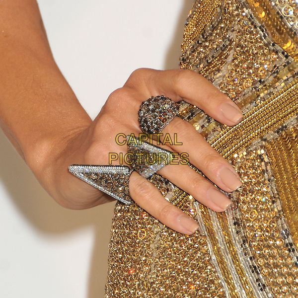 Heidi Klum's hand.21st Annual Elton John Academy Awards Viewing Party held at West Hollywood Park, West Hollywood, California, USA..February 24th, 2013.oscars on hip detail ring jewellery jewelry gold diamante sequins sequined silver diamonds art deco.CAP/ADM/BP.©Byron Purvis/AdMedia/Capital Pictures.