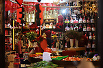 Palestinians gather at a shop selling red teddy bears, red ballons and pillows on Valentine's day in Gaza city on February 14, 2018. Valentine's Day is increasingly popular in the region as people have taken up the custom of giving flowers, cards, chocolates and gifts to sweethearts to celebrate the occasion. Photo by Ashraf Amra