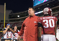 Hawgs Illustrated/BEN GOFF <br /> Bret Bielema, Arkansas head coach, greets players after they leave the field following their loss to Missouri Friday, Nov. 24, 2017, at Reynolds Razorback Stadium in Fayetteville. Bielema was fired after the game.