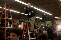 Journalists cover a Mitt Romney campaign event to begin at Gilchrist Metal Fabricating in Hudson, New Hampshire, on Jan. 9, 2012.  Romney is seeking the 2012 Republican presidential nomination.