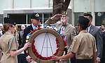 From left center, Bud Southard, president of the Navy League, veteran Charles Sehe and Gov. Brian Sandoval lay a wreath at the state memorial during the USS Nevada Centennial Ceremony at the Capitol in Carson City, Nev., on Friday, March 11, 2016. <br />Photo by Cathleen Allison