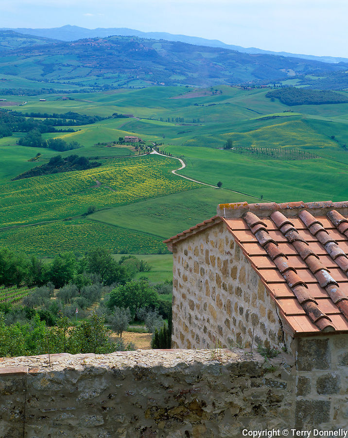 Tuscany, Italy, <br />  View of scattered farms and rolling green hills of the Val d'Orcia from the Hill town of Pienza