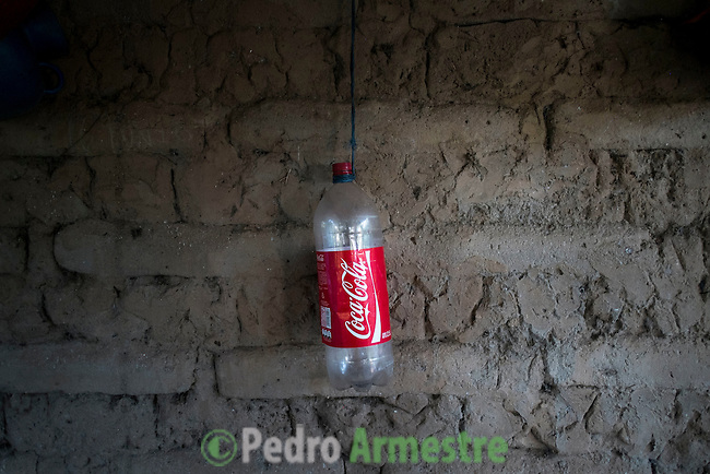 November 08, 2014. &quot;Water it&acute;s the real thing&quot;<br /> Raquel lives with her family in a house in Nejapa (El Salvador). Life is so difficult for her because she does'n' t have water at home. The people of Nejapa have no drinking water because the Coca -Cola company overexploited the aquifer in the area, the most important source of water in this Central American country. This means that the population has to walk for hours to get water from wells and rivers. The problem is that these rivers and wells are contaminated by discharges that makes Coca- Cola and other factories that are installed in the area. The problem can increase: Coca Cola company has expansion plans, something that communities and NGOs want to stop. To make a liter of Coca Cola are needed 2,4 liters of water. &copy;Calamar2/ Pedro ARMESTRE