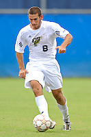 2 October 2011:  FIU midfielder/forward Nicholas Chase (8) moves the ball upfield in the first half as the FIU Golden Panthers defeated the University of Kentucky Wildcats, 1-0 in overtime, at University Park Stadium in Miami, Florida.
