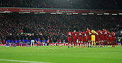 30th January 2019, Anfield, Liverpool, England; EPL Premier League football, Liverpool versus Leicester City; the players of both teams observe one minute silence in memory of Cardiff player Emilano Sala before the kick off