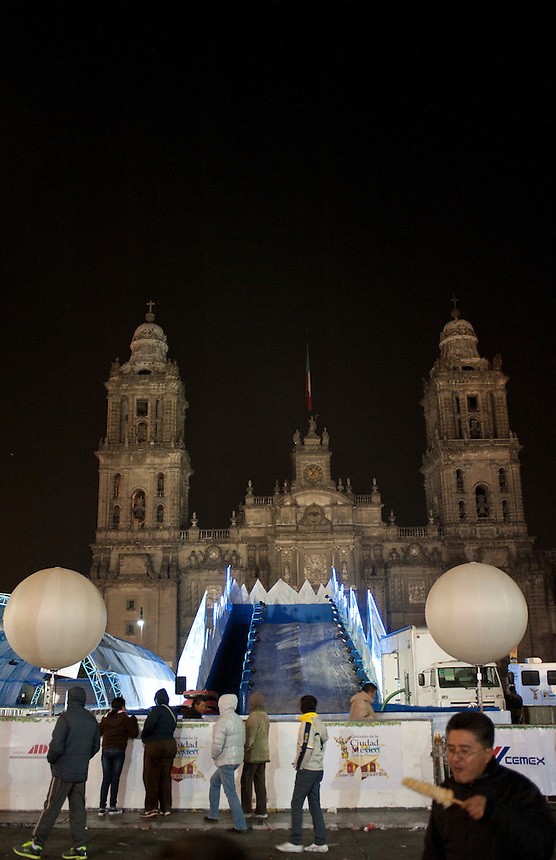Christmas decorations and winter rides in the Zocalo, main square. Night bicycle rides,  Mexico City.