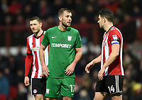 Preston's Tommy Spurr talks to Brentford's John Egan<br /> <br /> Photographer Jonathan Hobley/CameraSport<br /> <br /> The EFL Sky Bet Championship - Brentford v Preston North End - Saturday 10th February 2018 - Griffin Park - Brentford<br /> <br /> World Copyright &copy; 2018 CameraSport. All rights reserved. 43 Linden Ave. Countesthorpe. Leicester. England. LE8 5PG - Tel: +44 (0) 116 277 4147 - admin@camerasport.com - www.camerasport.com
