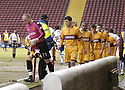 27/02/2010  Copyright  Pic : James Stewart.sct_jspa05_motherwell_v_kilmarnock  .::  MOTHERWELL PLAYERS HAVE TO RUN AROUND A CORDONED OFF AREA TO STOP THEM DIGGING UP THE SUFACE AS HE TOOK TO THE FIELD AT FIR PARK PRIOR TO START OFF THE GAME :: .James Stewart Photography 19 Carronlea Drive, Falkirk. FK2 8DN      Vat Reg No. 607 6932 25.Telephone      : +44 (0)1324 570291 .Mobile              : +44 (0)7721 416997.E-mail  :  jim@jspa.co.uk.If you require further information then contact Jim Stewart on any of the numbers above.........