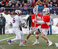 University at Albany Men's Lacrosse defeats Cornell 11-9 on Mar 4 at Casey Stadium.  Connor Fields (#5) shoots and scores the final goal against the on-charging Christian Knight (goalkeeper #40).