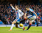 Lee Wallace snatches at a shot as Conrad Balatoni challenges