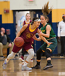 WATERBURY, CT-120818JS16- Sacred Heart's Mikayla Mobley (13) drives to the basket against Holy Cross' Allie Brown (12) during their game in the Waterbury girls basketball jamboree Saturday at Kennedy High School. <br /> Jim Shannon Republican American