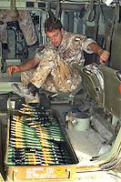 """- load of depleted uranium armor-piercing ammunitions for the 30 milimeter gun of an infantry armoured fighting vehicle VCC 80 """"Dardo""""....- carico delle munizioni perforanti all'uranio impoverito per il cannone da 30 mm di un veicolo corazzato da combattimento per fanteria VCC 80 """"Dardo"""""""