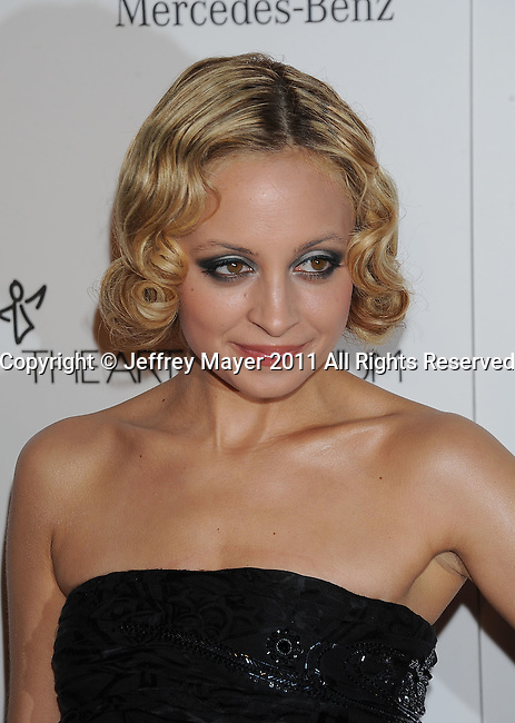 "LOS ANGELES, CA - January 15: Nicole Richie arrives at Art Of Elysium's 4th Annual ""Heaven"" Charity Gala at California Science Center's Wallis Annenberg Building on January 15, 2011 in Los Angeles, California."