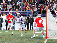 University at Albany Men's Lacrosse defeats Cornell 11-9 on Mar 4 at Casey Stadium.  Zach wolfe (#16) prepares to shoot on Cornell Goalkeeper Christian Knight (#40).