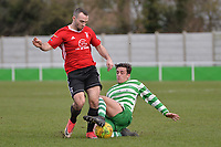 James McClurg of Bracknell Town is tackled by Rob Clark Of Waltham Abbey during Waltham Abbey vs Bracknell Town, Bostik League South Central Division Football at Capershotts on 9th February 2019