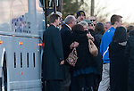 WOODBURY, CT 19 DECEMBER- 121912JS05- Mourners comfort one another after exiting a bus in front of  Munson-Lovetere Funeral Home in Woodbury on Wednesday for calling hours for Sandy Hook Principal Dawn Hochsprung. The bus was part of a caravan that included U.S. Secretary of Education, Arne Duncan.. Jim Shannon Republican American