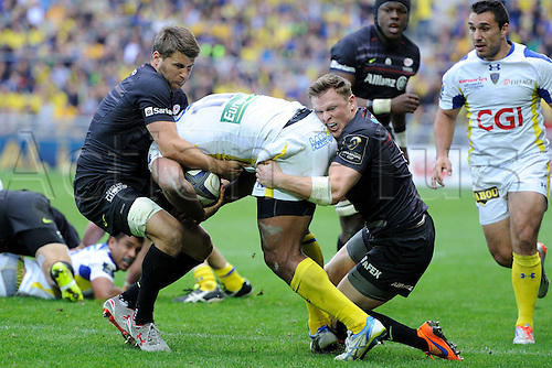18.04.2015. Clermont-Ferrand, Auvergne, France. Champions Cup rugby semi-final between ASM Clermont and Saracens.   Naipolioni Nalaga (asm) held up by Chris Wyles and Richard Wigglesworth (saracens)
