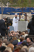 Arlington, VA - September 11, 2008 -- A United States Navy Sailor rings a bell as the name of each person lost at the Pentagon is read during the Pentagon Memorial dedication ceremony Sept. 11, 2008. The national memorial consists of 184 inscribed memorial units honoring the 59 people aboard American Airlines Flight 77 and the 125 in the building who lost their lives Sept. 11, 2001..Credit: Andy Morataya - DoD via CNP