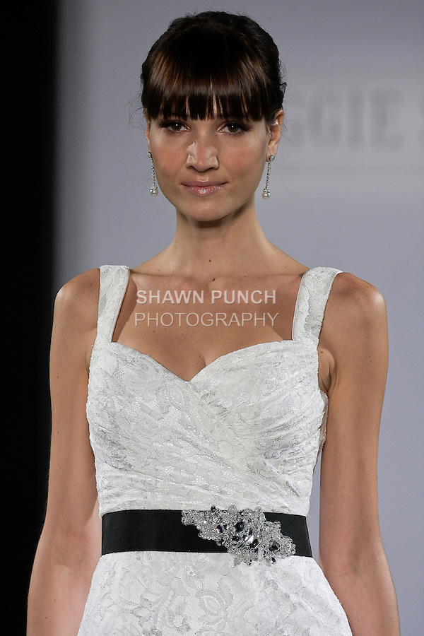 Model walks runway in a Kensington wedding dress from the Maggie Sottero Spring 2013 collection, at The Couture Show, during New York Bridal Fashion Week, on October 14, 2012.