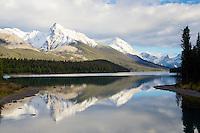 Leah Peak and Sampson Peak reflect in the waters of  Maligne Lake in Jasper National Park
