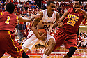 December 3, 2012: Dylan Talley (24) of the Nebraska Cornhuskers drives passed Byron Wesley (22) of the USC Trojans during the first half at the Devaney Sports Center in Lincoln, Nebraska. Nebraska defeated USC 63 to 51.