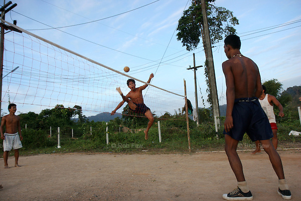 These men also work on a rubber plantation. Here they play Takraw, an Asian form of volleyball where hands are not used, before it gets dark and they have to start work.<br /> <br /> Like migrant communities all over the world, the Burmese in Thailand are often reviled by their hosts. as lazy, dirty and dishonest. The truth, as always, is completely different.