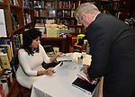 CORAL GABLES, FL - August 17: Steve Moss and author Dr. Carmen Harra (L) signs copies of her book 'The Karma Queens' Guide to Relationships' at Books and Books-Gables on Monday August 17, 2015 in Voral Gables, Florida.  ( Photo by Johnny Louis / jlnphotography.com )
