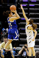 Columbus North guard Maliah Howard-Bass (22) shoots over Penn guard Kaitlyn Marenyi (10) during the IHSAA Class 4A Girls Basketball State Championship Game on Saturday, Feb. 27, 2016, at Bankers Life Fieldhouse in Indianapolis.