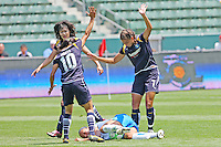 Amy LePeilbet #6 of the Boston Breakers is surrounded after being knocked down by Shannon Boxx #8 and Marta #10 of the Los Angeles Sol during their WPS match at Home Depot Center on May 10, 2009 in Carson, California.
