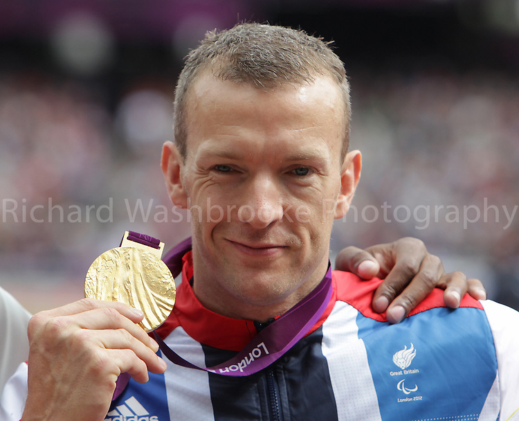 Paralympics London 2012 - ParalympicsGB - Athletics held at the Olympic Stadium 1st September 2012  .Richard Whitehead celebrating his gold medal after winning the men's 200m - T42 Final at the Paralympic Games in London. Photo: Richard Washbrooke/ParalympicsGB