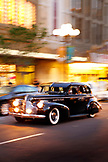 USA, California, San Diego, old cars speed off down the road near 5th Ave of the Gaslamp Quarter, a district of San Diego
