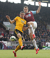 Wolverhampton Wanderers' Conor Coady vies for possession with Burnley's Chris Wood<br /> <br /> Photographer Rich Linley/CameraSport<br /> <br /> The Premier League - Burnley v Wolverhampton Wanderers - Saturday 30th March 2019 - Turf Moor - Burnley<br /> <br /> World Copyright © 2019 CameraSport. All rights reserved. 43 Linden Ave. Countesthorpe. Leicester. England. LE8 5PG - Tel: +44 (0) 116 277 4147 - admin@camerasport.com - www.camerasport.com