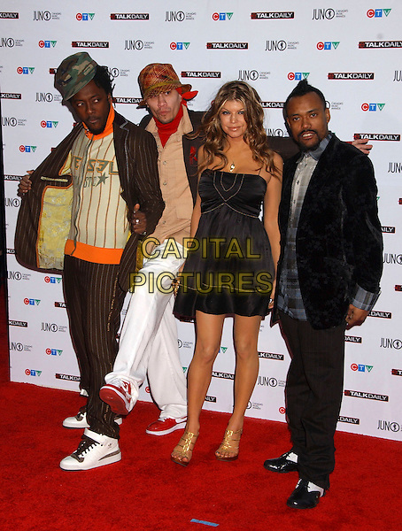TABOO, FERGIE, APL.DE.AP & WILL.I.AM.- BLACK EYED PEAS.The 35th Annual JUNO Awards held at the Halifax Metro Centre, Halifax, Nova Scotia, Canada. The JUNO Awards known as Canada's Music Awards are presented to Canada's best. .April 2nd, 2006.Photo: Laura Farr/AdMedia/Capital Pictures.Ref: LF/ADM.full length black dress white trousers hat brown pinstripe suit hat.www.capitalpictures.com.sales@capitalpictures.com.© Capital Pictures.
