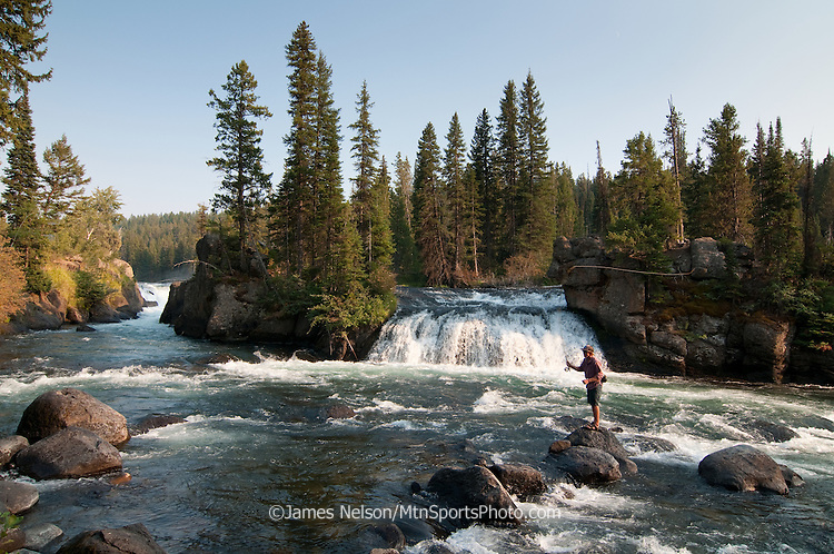 Jordan Nelson fly fishes near a waterfalls during an evening on a trout stream in Idaho.