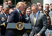 United States President Donald J. Trump greets head coach Jeff Monken as he presents the Commander-in-Chief's Trophy to the U.S. Military Academy football team in the Rose Garden of the White House in Washington, DC on Tuesday, May 1, 2018.  The Commander-in-Chief's trophy is presented to the winner of the annual Army-Navy football game which was played at Lincoln Financial Field in Philadelphia, Pennsylvania on December 9, 2017.  The Army Black Knights beat the Navy Midshipmen 14 - 13.<br /> Credit: Ron Sachs / CNP