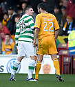 MOTHERWELL'S TIM CLANCY CLASHES WITH CELTIC'S GARY HOOPER