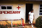 A nurse walks out of the local dispensary in Eskdale Tea Estate in Nuwareliya in Central Sri Lanka.  Photo: Sanjit Das/Panos