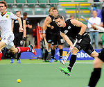 The Hague, Netherlands, June 08: Shea McAleese #25 of New Zealand passes the ball during the field hockey group match (Men - Group B) between the Black Sticks of New Zealand and Germany on June 8, 2014 during the World Cup 2014 at Kyocera Stadium in The Hague, Netherlands.  Final score 3-5 (1-3) (Photo by Dirk Markgraf / www.265-images.com) *** Local caption ***