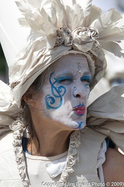 A performer  blows a kiss to the crowd while dancing during the 21st  Annual Fremont Summer Solstice Parade in Seattle on June 21, 2009.  The parade was held Saturday, bringing out painted and naked bicyclists, bands, belly dancers and floats. (Jim Bryant Photo © 2009)