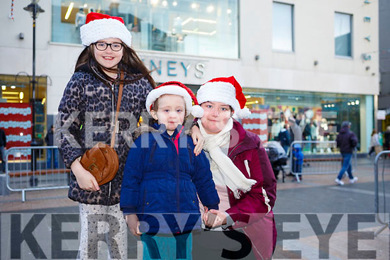 Waiting for Santa at CH Chemist Christmas Parade Tralee on Saturday were Leona Noonan, Abbie Noonan and Kelly Noonan