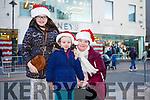 Waiting for Santa at CH Chemist Christmas Parade Tralee on Saturday were Leona Noonan, Abbie Noonan and Kelly Noonan