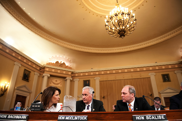 UNITED STATES - April 10 :  Rep. Michele Bachmann, R-Minn., Rep. Tom McClintock, R-CA., and Rep. Steve Scalise, R-LA., talk before the start of the Oversight Subcommittee hearing on the government's ability to prioritize its obligations and continue operations should the U.S. Treasury reach its statutory debt limit on April 10, 2013.  (Photo By Douglas Graham/CQ Roll Call)