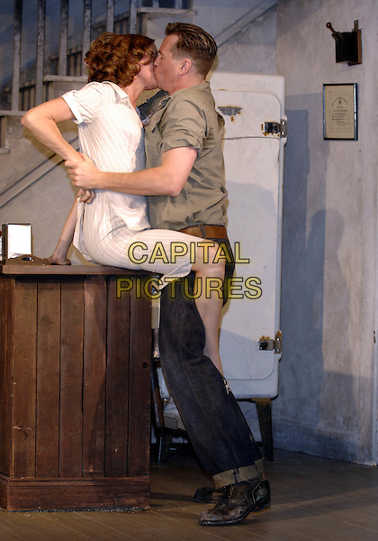 "CHARLOTTE EMMERSON & VAL KILMER.""The Postman Always Rings Twice"" production photocall.The Playhouse Theatre.London 31 May 2005..full length play costume stage kissing.www.capitalpictures.com.sales@capitalpictures.com.©Capital Pictures"