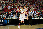 Wisconsin Badgers guard Josh Gasser (21) celebrates during the third-round game in the NCAA college basketball tournament against the Oregon Ducks Saturday, April 22, 2014 in Milwaukee. The Badgers won 85-77. (Photo by David Stluka)