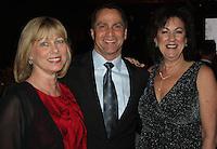 STAFF PHOTO CARIN SCHOPPMEYER Jodi Lightner, Mercy Health NWA Outstanding Volunteer honoree, from right, enjoys O Night Divine with Gary and Melanie Alecusan.