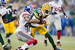 Green Bay Packers wide receiver James Jones (89) is tackled by New York Giants defensive back Corey Webster (23) during an NFL divisional playoff football game on January 15, 2012 in Green Bay, Wisconsin. The Giants won 37-20. (AP Photo/David Stluka)