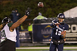 Nevada quarterback Cristian Solano (13) passes the ball over Hawaii's Justus Tavai (50) in the second half of an NCAA college football game in Reno, Nev., Saturday, Sept. 28, 2019. (AP Photo/Tom R. Smedes)